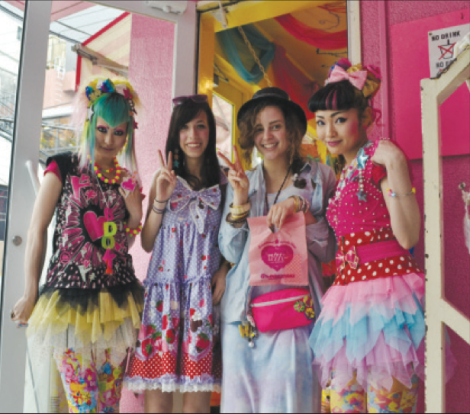 Carly Susman '13 and Lindsay Harris '13 pose with shop girls Yuka and Vani at the famous 6% Dokidoki Harajuku shop during a study abroad program in Japan. [Photo: Carly Susman].