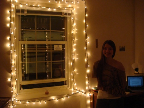Abbigail Jones '15 poses beside decorative lights in her room. (Photo: Michelle Tirto)