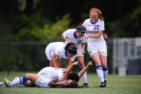 Members of the Women's Soccer Team celebrate a goal. (Photo: Goucher Women's Soccer Facebook)