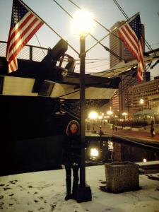 Kahlia Johnson Poses in the  Inner Harbor in the Snow. Photo: Kahlia Johnson