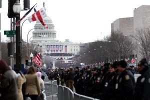 Proud Americans show their pride for President Obama during his second inauguration on capitol hill. (Photo: Billie Weiss ).