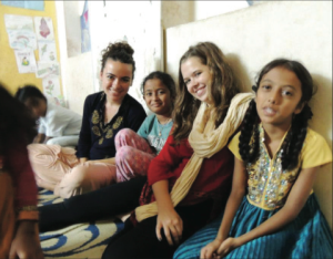 Ryan Derham '14 (Left) spent the fall semester studying at Christ College in Bangalore, India, where she volunteered as a teacher in the Ekipura Slum. (Photo Courtesy: Ryan Derham)