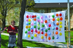 Leila Hanna-Kohen '15 runs GEAR's interactive paint balloon popping piece. (Photo: Romy Ackerberg)