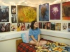 Tianna Mignogna relaxing in front her plethora of posters. (Photo: Michelle Tirto)