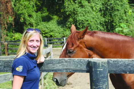 Equestrian Coach Jennifer Bunty posing with one of the horses. (Photo: Lauren Steinhoff)