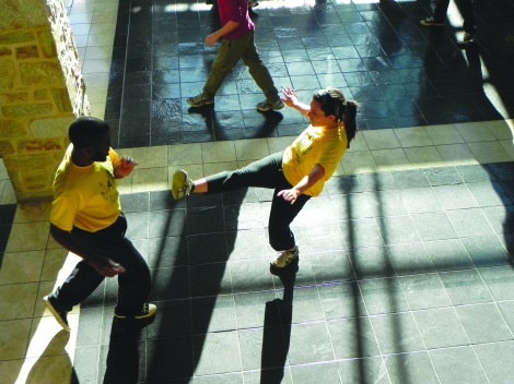 Members of the Capoeira Club practicing in the Pearlstone Atrium. (Photo: Tori Russell)