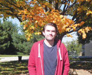 Adam Dawson outside Frolicher Hall enjoying autum at Goucher (Photo: Anna Martin)