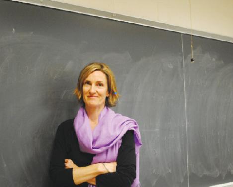 Professor Alish Hopper in a Van Meter classroom between classes. (Photo: Rachel Brustein)