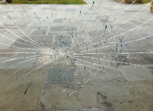 Broken glass door in the main entrance to Heubeck. (Photo: Anna Martin)