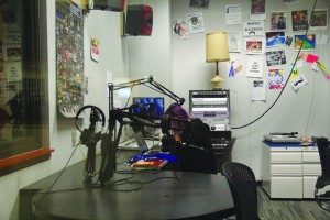Savannah Fisher '14 hosting her radio show in the Sanford J. Ungar Radio Studio. (Photo: Rachel Brustein)