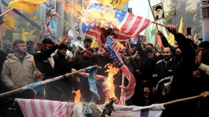 Irani protesters burning American flags at a rally (Photo: Google Images)