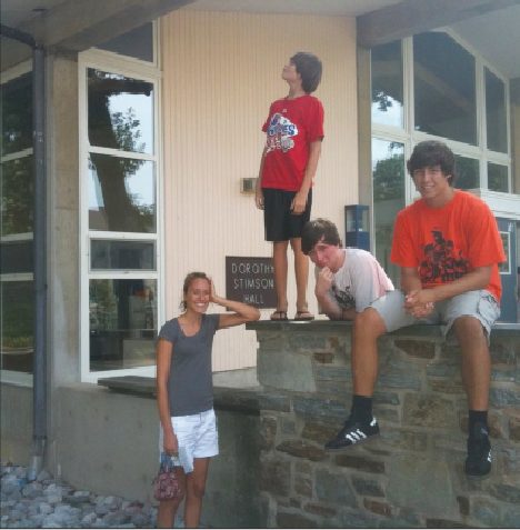 Kathryn Walker '14 and her brothers outside Stimson Hall after moving in Freshman year (Photo: Courtesy of Kathryn Walker)